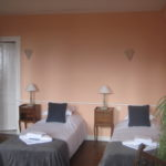 lits simples chambre rose